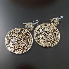 Big, bold, modern design earrings. Yellow gold tone with tiny sparkly crystals. Fashion chic modern jewelry. www.zorandesignsjewelry.com