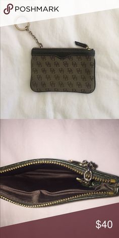 Dooney and Bourke Wristlet Wallet Keychain Small keychain Wristlet by dooney & bourke in olive green / dark beige with signature print. Excellent used condition. Has a detachable Wristlet strap as well as a keychain to attack to wrist or inside a purse or onto keys. Make me an offer! No trades please 😊💕💕💕 Dooney & Bourke Bags Clutches & Wristlets