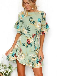 Ruffled floral print mini dress with a belt, a boat neckline. #floralprint #dresses #fashiontrends