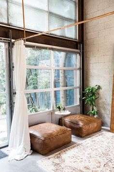 Industrial wedding boutique with leather poufs, and bronze floating rods