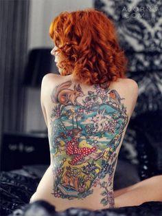 Red tail boa tattoo