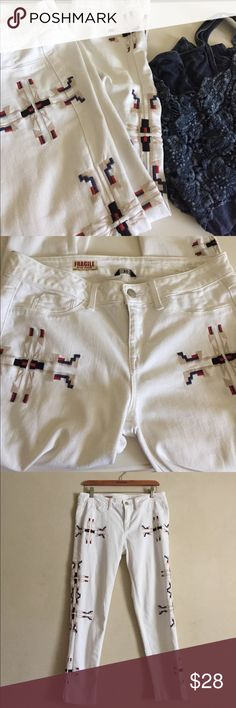 "Fragile Tribal Design Jeans White jeans with tribal style embroidery along the side seams. Great jeans for the summer. Fabric is stretchable. Great condition. Waistband from side to side is 17"", inseam 25"". Cropped skinny style. Fragile Blue Jeans Jeans Ankle & Cropped"