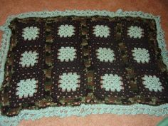 Pretty in Camo Crochet Blanket | Crochet granny squares make up this unique and colorful blanket pattern.