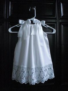 Pillow Case Dress--Instead of bows, I'm thinking of using regular straps and using it as a lace slip for the little one