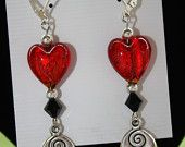 Dangle earrings w/ red foiled glass heart, black crystal, silver metal beads & silver charm w/ Sterling silver plated, lever back ear hooks.