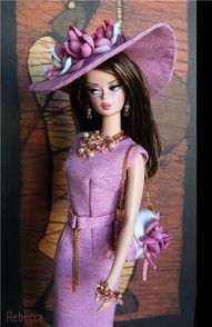 I love her hat! I wish I had barbies like this when I was growing up! Haha