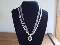 green stone in silver plated setting 1 pendant by SecChnceTreasure, $9.00