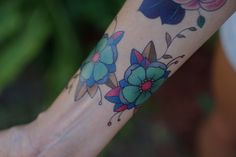 … plus these badass blossoms. | 17 Fake Tattoos So Good You'll Wish They Were Actually Real