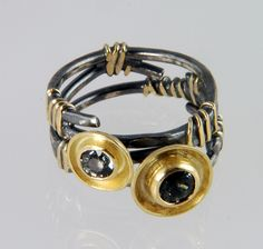 Adele Taylor - FlourishRing in oxidized silver, 18ct gold set with two colour-change sapphires £460