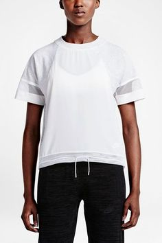 "This mesh-, silk-, and cotton-paneled style befuddled my boyfriend (""looks like futuristic hospital scrubs"" was the official review). Nonetheless, I found it to be a breezy upgrade on a standard tee. Nike Bonded T-Shirt, $55 $34.97, available at Nike.  #refinery29 http://www.refinery29.com/best-athleisure-workout-clothing#slide-23"
