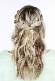 A pretty spin on the classic half-up half-down bridal hairstyle, this 'do is versatile and easy to create on your own. Get the tutorial at TwistMePretty »