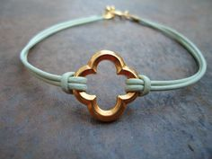 Mint Green Leather Gold Quatrefoil Clover Bracelet. via Etsy.