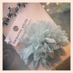 Sweet blue hair flower from Enchanted Atelier. All their flowers and lace are handmade in France