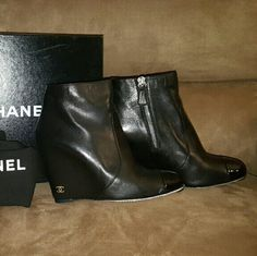 Authentic Chanel Black Wedges Short Boots /Booties Authentic Chanel Black bootie wedges with zipper. Made in Italy. Size 38.5, US 8. The boots are in excellent condition. The leather is still very soft, no cracks. The only wear is on the soles and a scratch on the front of the right boot that's not noticeable unless looking very closely. Serial inside boots A G27013. Comes with dust bag per boot and box.  NO TRADES. Thanks for looking! CHANEL Shoes Ankle Boots & Booties