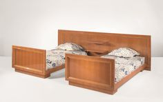 JEAN ROYÈRE Pair of 'studded' beds with integrated headboard, c. 1962  Lemon-veneered wood, brass. 90.2 x 200.7 x 301 cm (35 1/2 x 79 x 118 1/2 in)