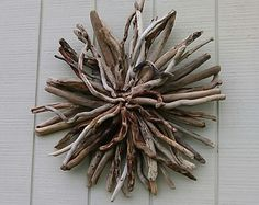 Driftwood Wall Hanging Sunburst Beach Wall Art Round Wood Coastal Decor. Enjoy the beach in your own home or yard with this naturarally twisted driftwood hand made sunburst. This sunburst measures 26x26x5 inches. I made it with driftwood I collected at the ocean. I love making these because each one is different and I never know they will turn out. They are all one of a kind made one at a time by me. Thank you so much for looking at Burlgirl Creations.  For more driftwood sunbursts click…