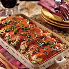 Chicken Cannelloni with Roasted Red Bell Pepper Sauce--1 (8-ounce) package cannelloni or manicotti shells  4 cups finely chopped cooked chicken  2 (8-ounce) containers chive-and-onion cream cheese  1 (10-ounce) package frozen chopped spinach, thawed and well drained  1 cup (8 ounces) shredded mozzarella cheese  1/2 cup Italian-seasoned breadcrumbs  3/4 teaspoon garlic salt  1 teaspoon seasoned pepper  Roasted Red Bell Pepper Sauce  Garnish: chopped fresh basil or parsley