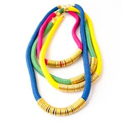 This is our favorite classic cord statement necklace. Hand dyed cotton cord in beautiful colors for a color bock necklace look. Choose from yellow / Green / Blue / Pink to make a statement with this rope necklace. Perfect Mothers Day gift! Pretty colorful rope and rings statement necklace. Perfect layering necklace, choose from 3 different lengths: 18 / 22 / 26. Buy one or buy a mix of colors and lengths to make an even bigger statement! This necklace will match ANY o...