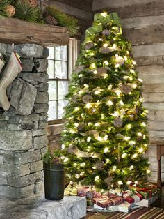 A beautiful Christmas cabin. Inveterate collector Travis Robeson fills his Tennessee cabin with simple and rustic decorations, like burlap ribbon and carved-wood cookie molds. Read more: Christmas Home Decorations - Homes Decorated for Christmas - Country Living