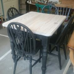 Pitch pine table and 4wheelback chairs in Graphite Chalkpaint ™ whitewashed tabletop.