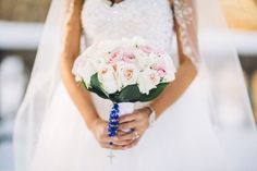 A soft-hued bouquet with blue rosary beads {Too Much Awesomeness}