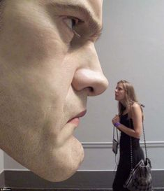 By London artist named Ron Mueck, who specializes in sculptures. He used to be a model maker and puppeteer for television and films (for example, he created Ludo the gentle giant in Labyrinth). Now, he focuses on making hyper-realistic sculptures of humans that have museum visitors staring for hours...