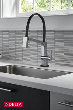 The Pivotal® Collection was designed with a global appeal in mind. The collection was inspired by the diversity of lines and curves found throughout the architecture of cosmopolitan metros like New York City. Kitchen Fixtures, Kitchen Faucets, Delta Design, White Kitchen Inspiration, Small White Kitchens, Unique Tile, White Wall Decor, Cosmopolitan, Modern Minimalist
