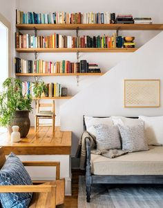 a funky nook is turned into a spot for bookshelves and plants | room via coco kelley