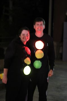 Go as stoplights by wrapping touch lights from the Dollar Store in red, green and yellow tissue paper and duct taping them to black clothing with black duct tape.