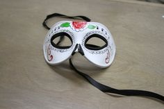 Ships within 1 business day! U.S. customers will receive their orders within 5 business days. Priority & Express shipping options are available.  Carefully designed and hand-painted. Worn with silk ribbons attached to sides of the mask. New model  Color: White resin mask with red flower  Product Description>>>>>>>>>>>>>>> Made with high quality eco-friendly (recyclable) poly resin. Mask measures approximately 7W x 4*H. Perfect for all masquerade events, weddings, proms, Mardi Gras, photo…