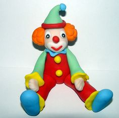 (check this out! its EDIBLE!!!! ~imelda~)     Fondant Circus Clown Cake Topper : )