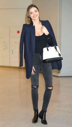 Need jeans outfit ideas? Get inspired by these celebrities and models who know how to style jeans and denim to perfection: Miranda Kerr wears black skinny jeans with a blazer and booties