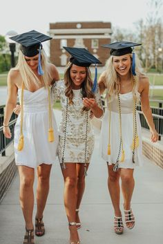 Fun college graduation photo by Samantha Rice Photography. These three best friends got together for a graduation photo shoot! Beautiful gold heels with this gold and white sequin dress! Taken at Western Michigan University East Campus Go Broncos.