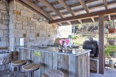 Extraordinary Outdoor Bar Stools decorating ideas for Foxy Porch Farmhouse design ideas with granite countertop limestone outdoor bar outdoor kitchen reclaimed barn wood rustic wood
