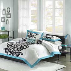 @Overstock - This bedding set offers the perfect design solution for any young girl transitioning to a more grown-up room. Featuring a bold black leaf motif on a bright white background with a teal border, the duvet reverses to a teal and white floral print.http://www.overstock.com/Bedding-Bath/Mizone-Santorini-Teal-4-piece-Duvet-Cover-Set/6629620/product.html?CID=214117 $42.59