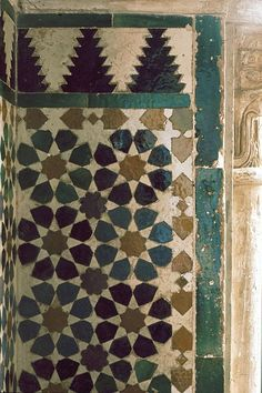 Image SPA 1009 featuring decorated area from the Alhambra, in Granada, Spain, showing Geometric Pattern using ceramic tiles, mosaic or pottery.