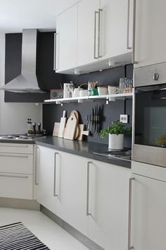Add a shelf for commonly used spices, bowls, etc. with under-cabinet lighting.