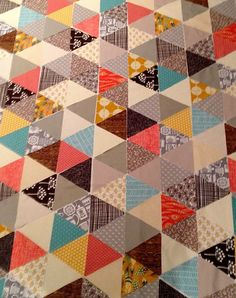 Equilateral triangle quilt  http://thewindyside.blogspot.co.nz/2012/09/equilateral-triangle-quilt.html