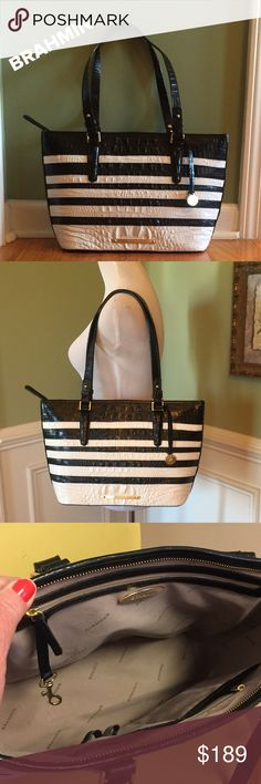 """Brahmin Black & White Zip Leather Tote Ooh-La-La 😍. Excellent condition, carried less then a dozen times. Colors are Black and White. A great anytime bag!!!  Beautiful interior with 2 zip pockets and 2 slip pockets, attached key holder. Protection feet. Gold tone hardware. Measures 16""""x10""""x5"""" w/12"""" adjustable strap drop. Classy!!! Brahmin Bags Totes"""