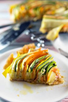 Spiral Vegetable Tart: thinly sliced vegetables are the visual star of this edible artwork. With a layer of homemade sundried tomato pesto and a flaky pie crust, this tart is as delicious as it is beautiful! Vegan and gluten free options, too! Whole Foods Vegan, Whole Food Recipes, Cooking Recipes, Tart Recipes, Thanksgiving Vegetable Sides, Thanksgiving Recipes, Vegetable Tart, Vegetable Side Dishes, Vegetable Recipes