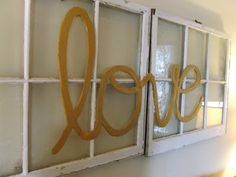 "DIY - ""love"" foam board cut-out over thrift store windows"