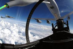 The refueling boom from a KC-135 Stratotanker arches over an F-15 Eagle as it refuels the aircraft over eastern Florida, Sept. 20, 2008. An F-22 Raptor and another F-15 Eagle from Tyndall Air Force Base, Fla., are participating in the training mission with the Mississippi Air National Guard. U.S. Air Force photo by Master Sgt. Scott Reed
