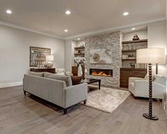 201 custom and luxury family room design ideas in pictures. Huge array of family room furniture, styles, color schemes, layouts and amenities. Living Room With Fireplace, New Living Room, Living Room Interior, Living Room Decor, Gray Interior, Basement Fireplace, Basement Walls, Interior Paint, Best Flooring For Basement