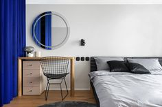 A Compact 65m2 Apartment in Kiev Separated by Blue Curtains - Design Milk