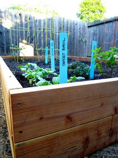How to build a raised garden bed, with supply list, step by step written and photo directions!