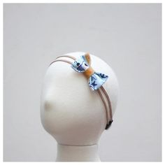 Please read the entire description thoroughly prior to purchasing. Pirate themed fabric bow with mustard leather accent and suede bands. Headband has an elastic
