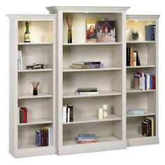 Showcasing adjustable shelves and fluted columns, this bookcase set showcases top shelf lights and is perfect for displaying leather tomes and treasured trav...