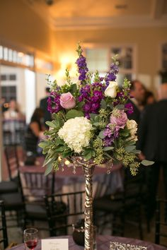 Beautiful puple and white wedding ceremony centerpiece with hydrangea, stock, larkspur, roses, seeded eucalyptus, and pit