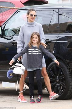 Touch of colour: Alessandra wore the sweater with a pair of orange Puma sneakers