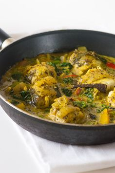 Cinnamon and coconut stew fish curry - succulent fish fillets slow cooked in a herbaceous coconut sauce.